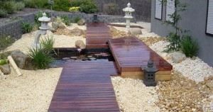 Traditonal design aspects with a modern look to this Japanese water garden