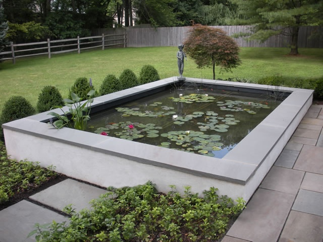 Pond design ideas raised koi ponds pond stars uk dorset for Koi pool decor