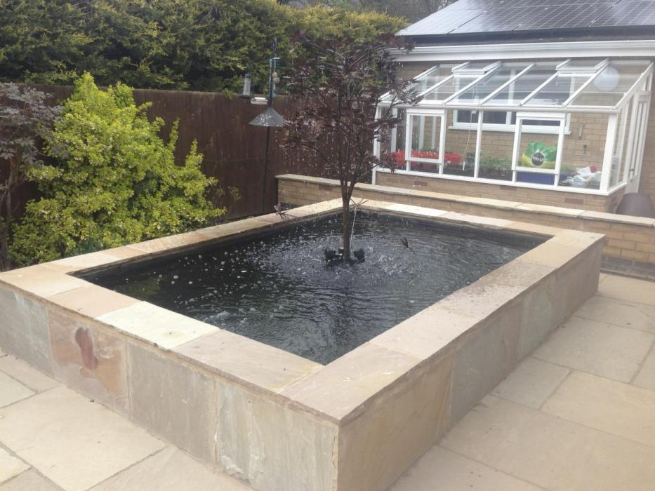 Pond design ideas raised koi ponds pond stars uk dorset for Plastic garden fish ponds