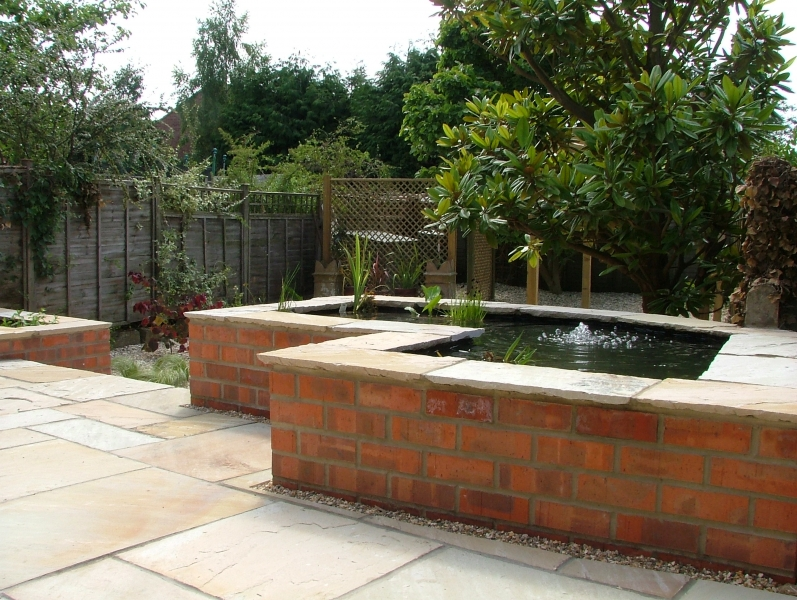 Pond design ideas raised koi ponds pond stars uk dorset for Modern koi pond design